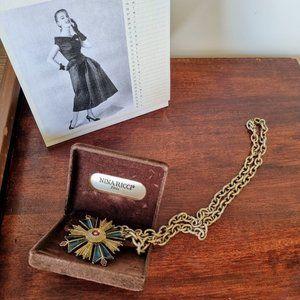 Vintage Nina Ricci enamel pendant